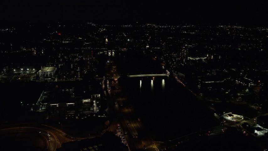 6K stock footage aerial video approaching Western Avenue Bridge, Harvard University, Massachusetts, night Aerial Stock Footage   AX141_116
