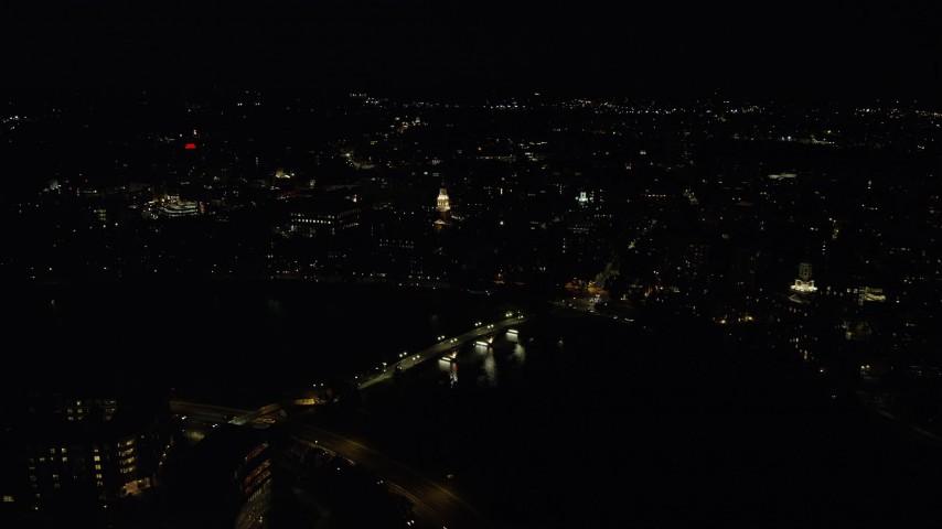 6K stock footage aerial video flying by Lowell House, John W. Weeks Bridge, Harvard University, Massachusetts, night Aerial Stock Footage | AX141_118