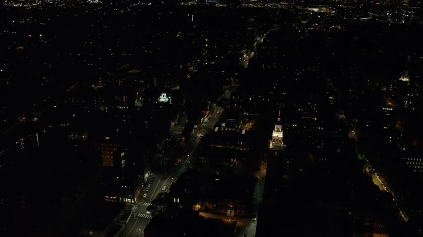 6K stock footage aerial video orbiting Lowell House, Adams House, Mt Auburn Street, Harvard University, Massachusetts, night Aerial Stock Footage | AX141_122