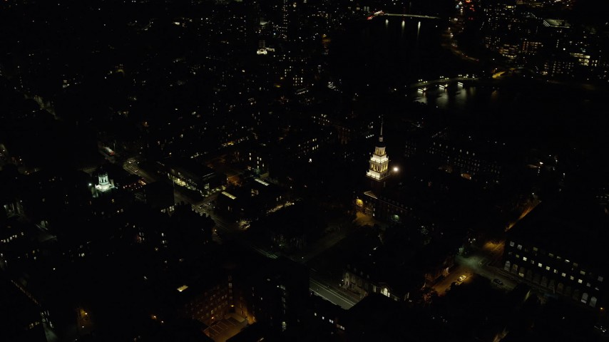 6K aerial video orbiting illuminated Lowell House, Adams House, Harvard University, Massachusetts, night Aerial Stock Footage | AX141_123