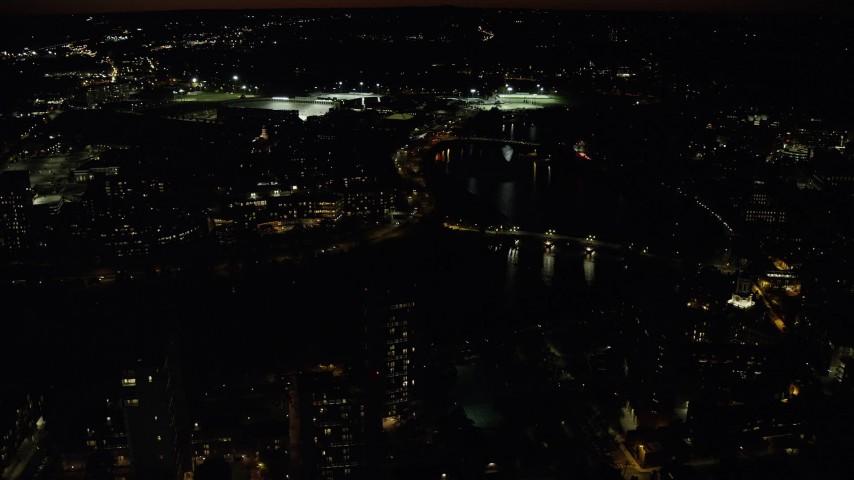 6K stock footage aerial video of John W. Weeks Bridge and Anderson Memorial Bridge, Harvard University, Massachusetts, night Aerial Stock Footage | AX141_126