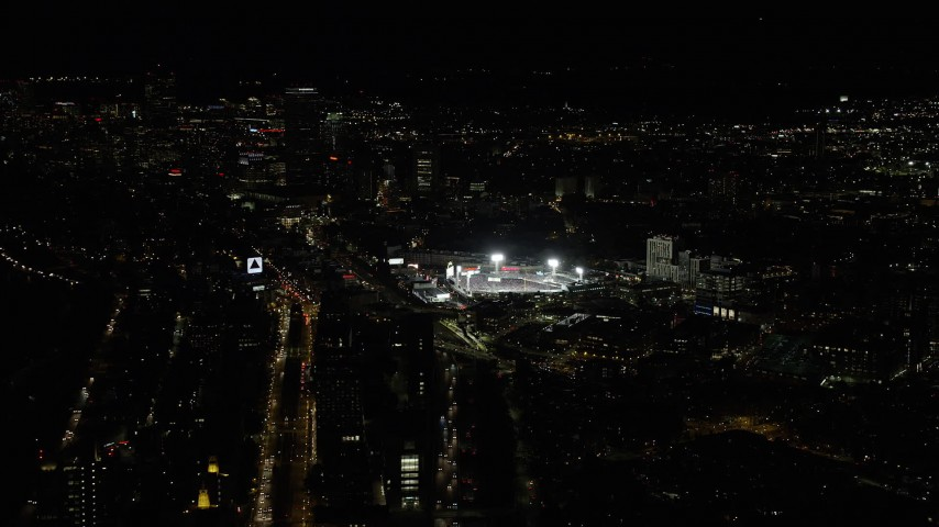 6K stock footage aerial video of a baseball game in progress, Fenway Park, Downtown Boston, Massachusetts, night Aerial Stock Footage | AX141_128