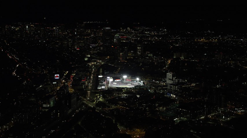 6K stock footage aerial video flying by skyscrapers, baseball game, Fenway Park, Downtown Boston, Massachusetts, night Aerial Stock Footage | AX141_129