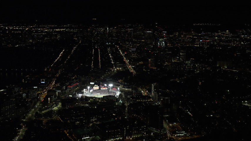 6K stock footage aerial video of a baseball game in progress at Fenway Park, Downtown Boston, Massachusetts, night Aerial Stock Footage   AX141_131