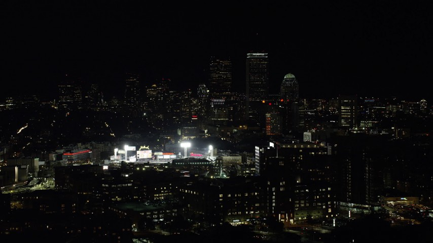 6K stock footage aerial video flying by downtown skyline, Fenway Park, Downtown Boston, Massachusetts, night Aerial Stock Footage | AX141_141