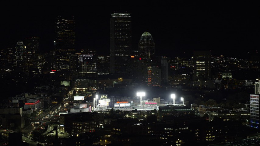 6K stock footage aerial video flying by lights of Fenway Park, Downtown Boston, Massachusetts, night Aerial Stock Footage | AX141_142