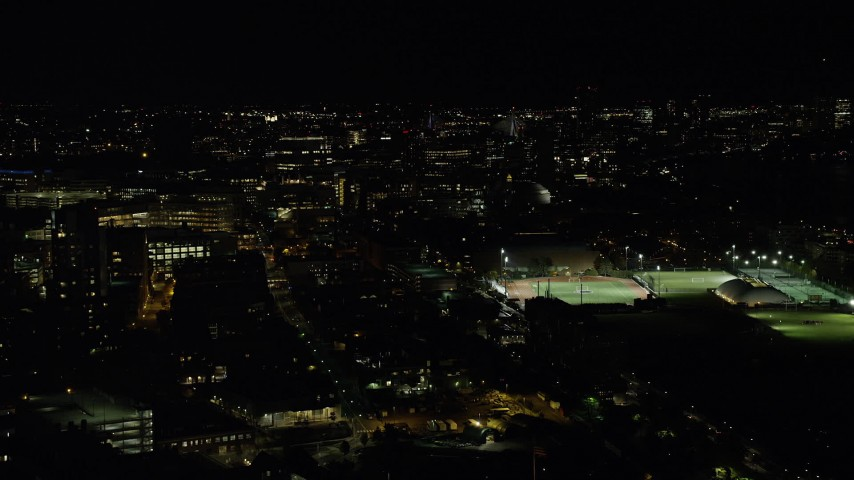 6K stock footage aerial video of Massachusetts Institute of Technology, sports fields, Cambridge, Massachusetts, night Aerial Stock Footage | AX141_145