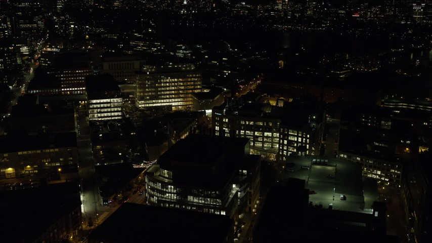 6K stock footage aerial video flying by office buildings, Massachusetts Avenue, Cambridge, Massachusetts, night Aerial Stock Footage   AX141_150