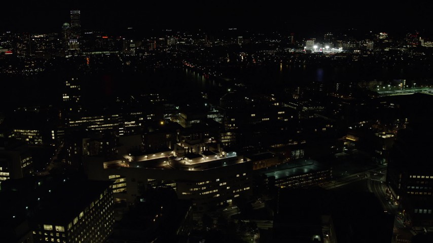 6K stock footage aerial video flying by MIT, Massachusetts Institute of Technology, Cambridge, Massachusetts, night Aerial Stock Footage | AX141_153
