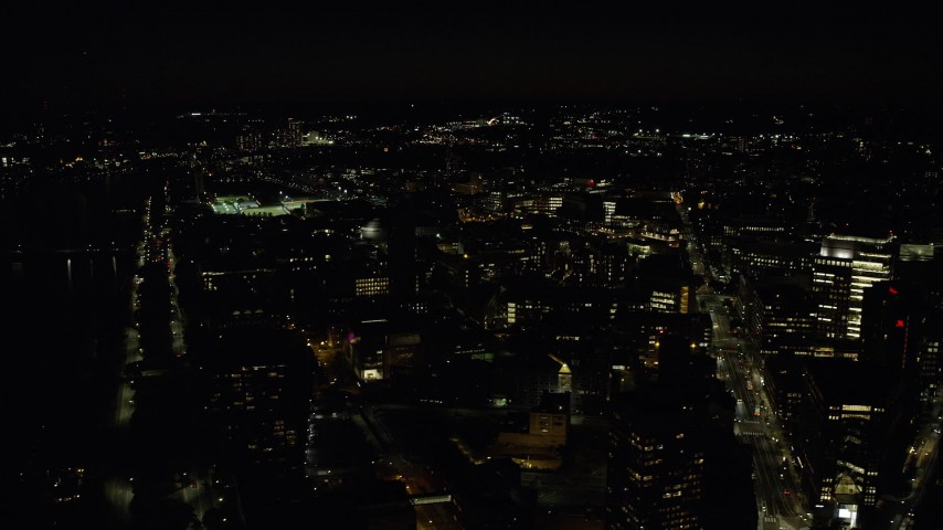 6K stock footage aerial video flying by MIT campus, Massachusetts Institute of Technology, Cambridge, Massachusetts, night Aerial Stock Footage | AX141_156
