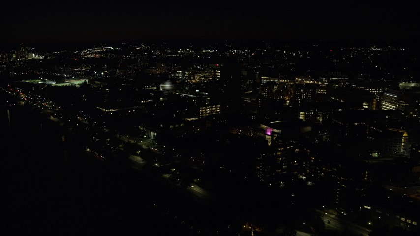 6K stock footage aerial video flying by campus buildings, Massachusetts Institute of Technology, Cambridge, Massachusetts, night Aerial Stock Footage | AX141_157