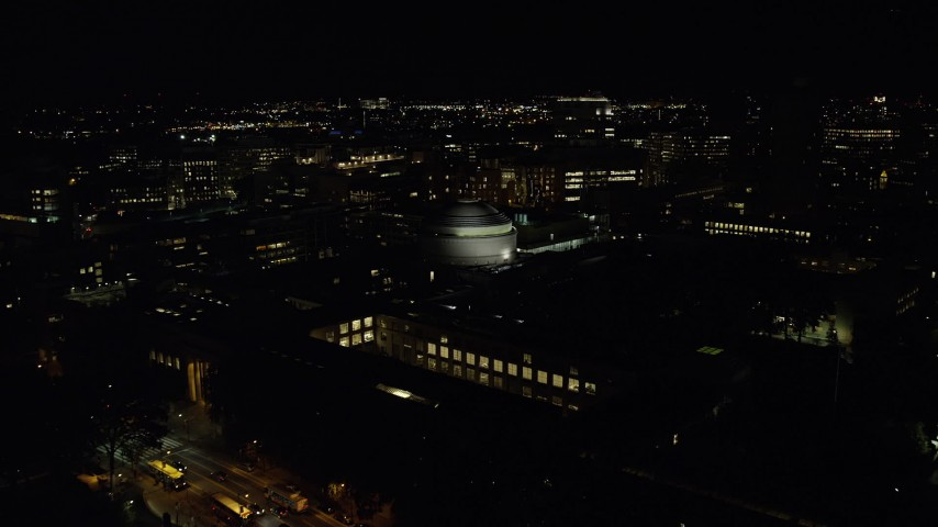 6K stock footage aerial video flying over Maclaurin Building, approach Stata Center, Massachusetts Institute of Technology, Cambridge, Massachusetts, night Aerial Stock Footage | AX141_164