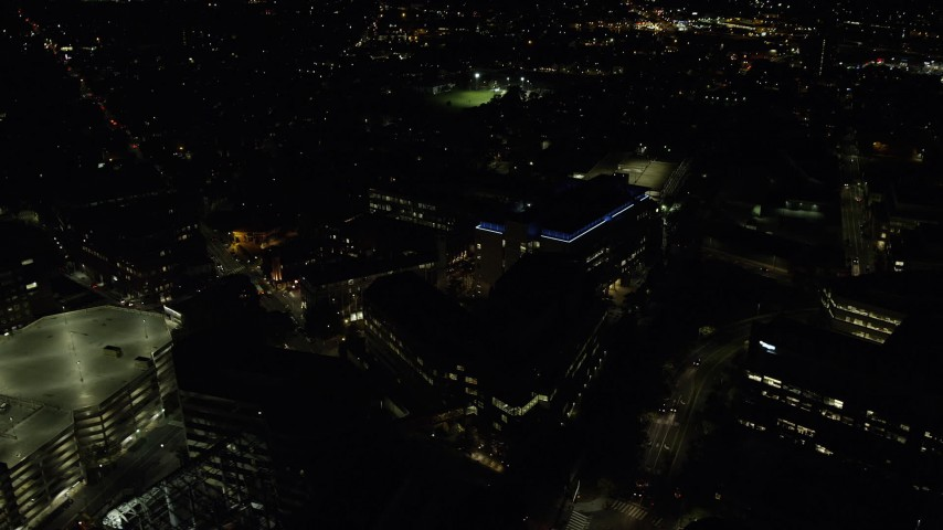 6K stock footage aerial video flying by office buildings, sports fields, Cambridge, Massachusetts, night Aerial Stock Footage | AX141_166