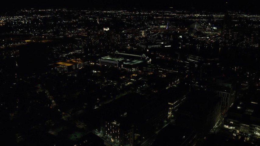 6K stock footage aerial video flying by office buildings, city lights, Cambridge, Massachusetts, night Aerial Stock Footage | AX141_167