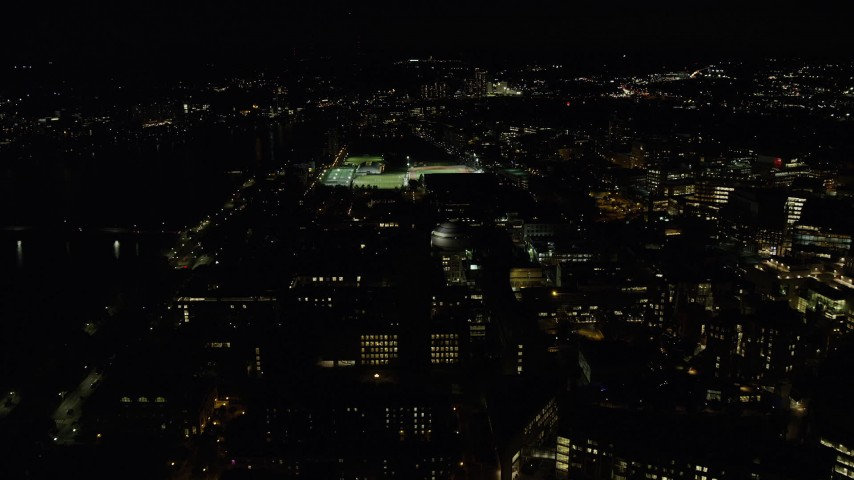 6K stock footage aerial video approaching Maclaurin Building, sports fields, Massachusetts Institute of Technology, Cambridge, Massachusetts, night Aerial Stock Footage | AX141_168