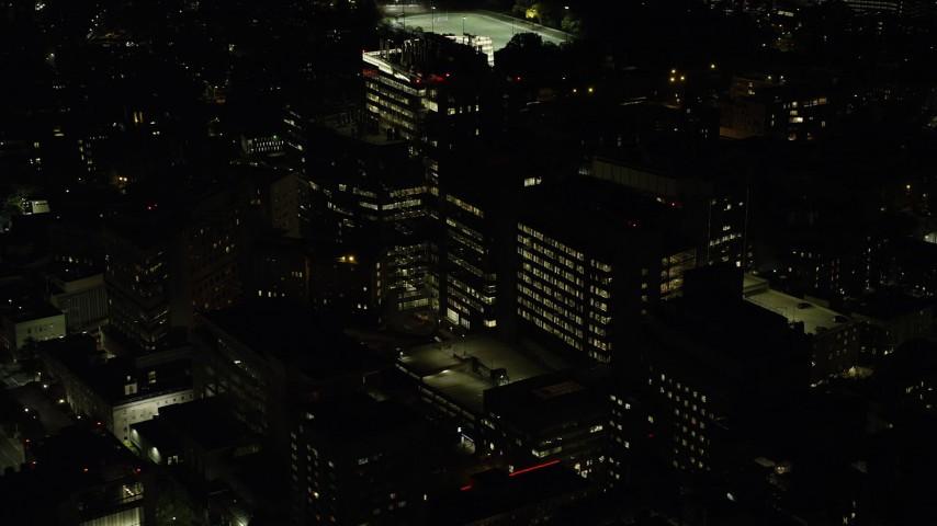 6K stock footage aerial video orbiting Beth Israel Hospital, Longwood Medical Area, Boston, Massachusetts, night Aerial Stock Footage | AX141_175