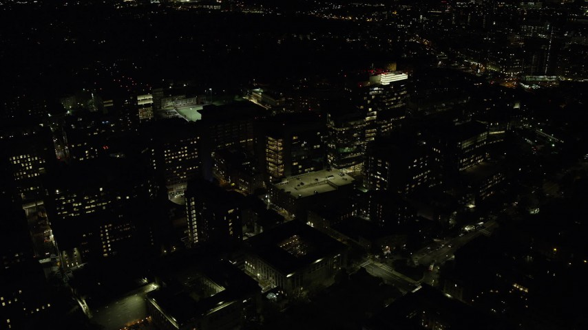 6K stock footage aerial video orbiting Longwood Medical Area, city lights, Boston, Massachusetts, night Aerial Stock Footage | AX141_177