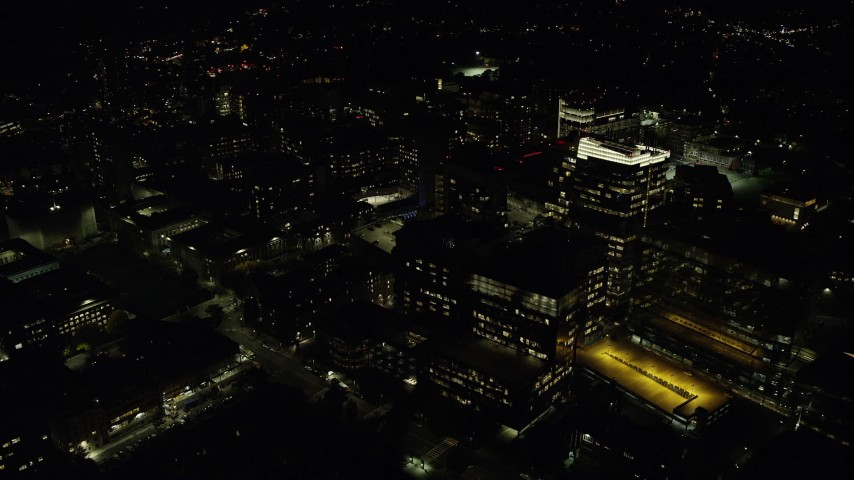 6K stock footage aerial video orbiting city lights, Longwood Medical Area, Boston, Massachusetts, night Aerial Stock Footage | AX141_179