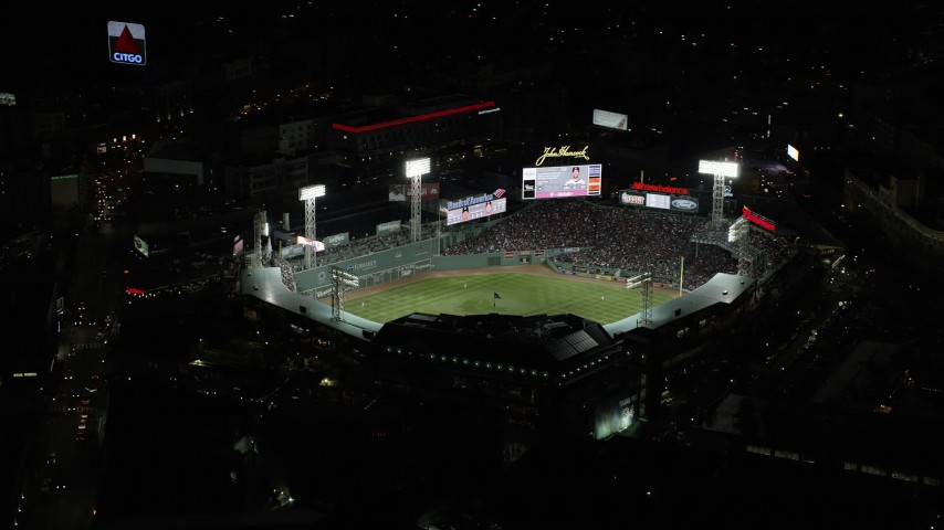 6K stock footage aerial video flying away from baseball game, Fenway Park, Boston, Massachusetts, night Aerial Stock Footage | AX141_180