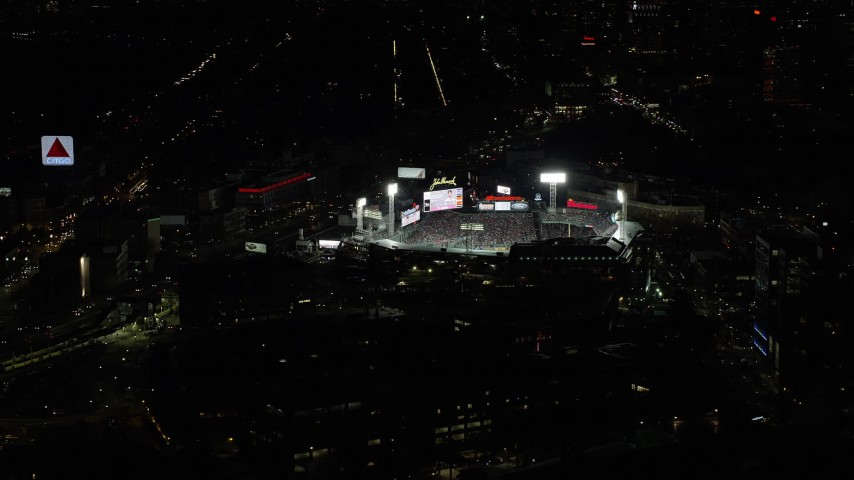 6K stock footage aerial video orbiting city streets, baseball game at Fenway Park, Boston, Massachusetts, night Aerial Stock Footage | AX141_181
