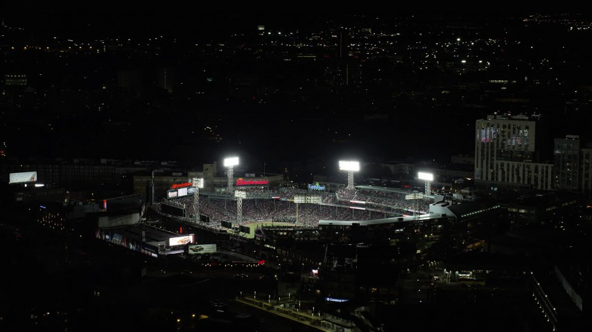 6K stock footage aerial video orbiting crowded stadium, Fenway Park, Boston, Massachusetts, night Aerial Stock Footage | AX141_183