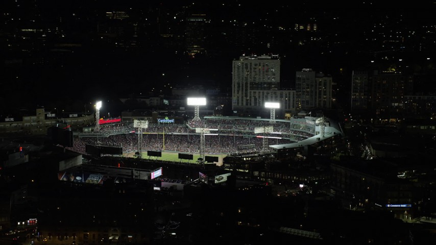 6K stock footage aerial video orbiting Boston Red Sox game at Fenway Park, Boston, Massachusetts, night Aerial Stock Footage | AX141_184