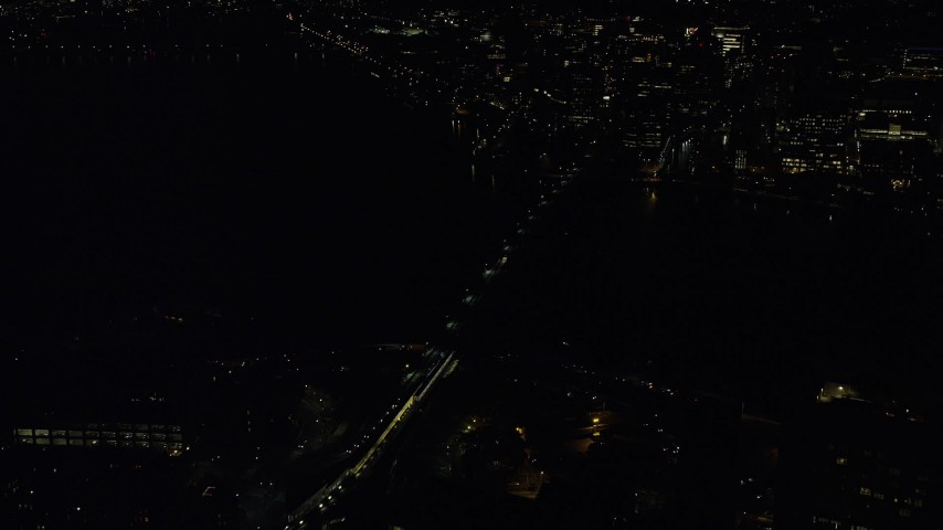 6K stock footage aerial video approaching Longfellow Bridge and tilt down, Boston, Massachusetts, night Aerial Stock Footage | AX141_198