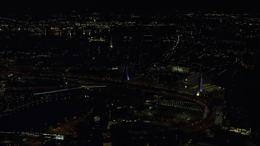 6K stock footage aerial video flying by Zakim Bridge, approach Bunker Hill Monument, Charlestown, Massachusetts, night Aerial Stock Footage | AX141_199