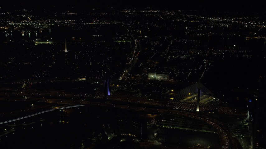 6K stock footage aerial video approaching Zakim Bridge, Bunker Hill Monument, Charlestown, Massachusetts, night Aerial Stock Footage | AX141_200
