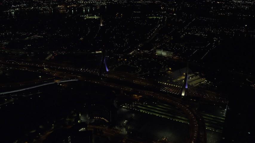 6K stock footage aerial video flying by the Zakim Bridge, Boston, Massachusetts, night Aerial Stock Footage | AX141_201