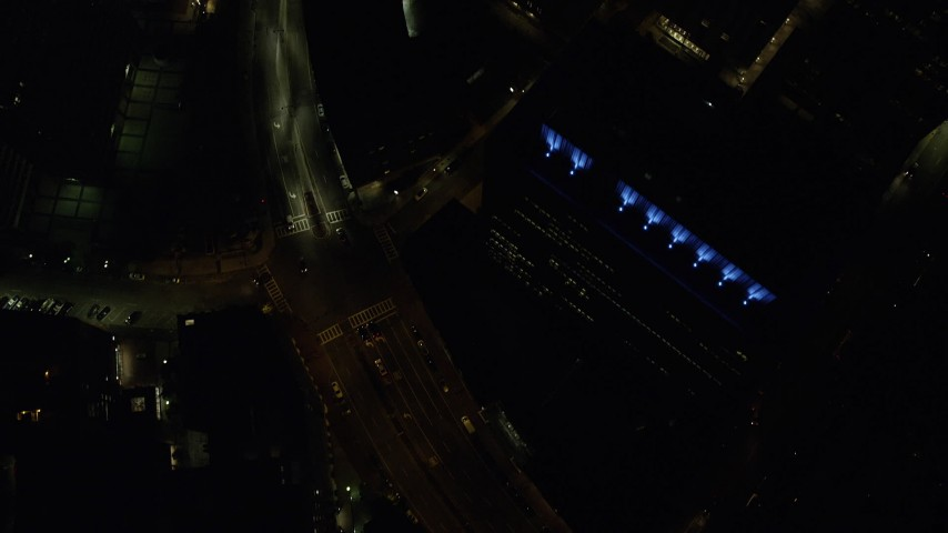 6K stock footage aerial video of a bird's eye view flying over city streets, skyscrapers, Downtown Boston, Massachusetts, night Aerial Stock Footage | AX141_203