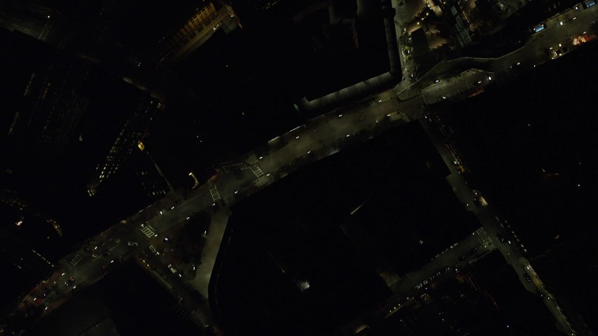 6K stock footage aerial video of a bird's eye view over downtown city streets, Boston, Massachusetts, night Aerial Stock Footage | AX141_205