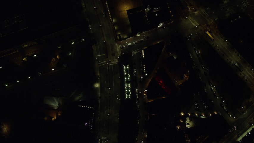6K stock footage aerial video of a bird's eye view over city streets, very light traffic, Downtown Boston, Massachusetts, night Aerial Stock Footage   AX141_214