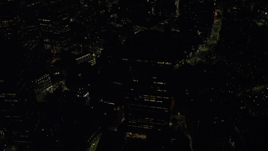 6K stock footage aerial video approaching One Beacon Street, tilt down, Downtown Boston, Massachusetts, night Aerial Stock Footage | AX141_215