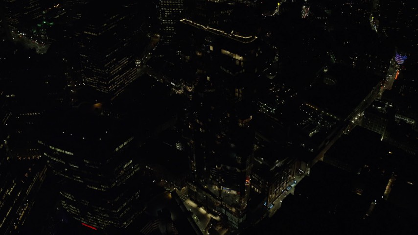 6K stock footage aerial video flying by the Millennium Tower, Downtown Boston, Massachusetts, night Aerial Stock Footage | AX141_216