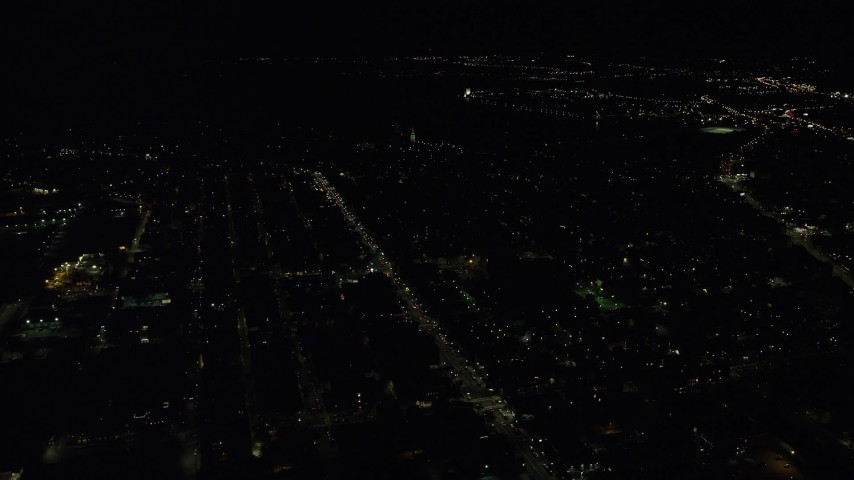 6K stock footage aerial video flying by Broadway, Dorchester Heights Monument, South Boston, Massachusetts, night Aerial Stock Footage | AX141_219