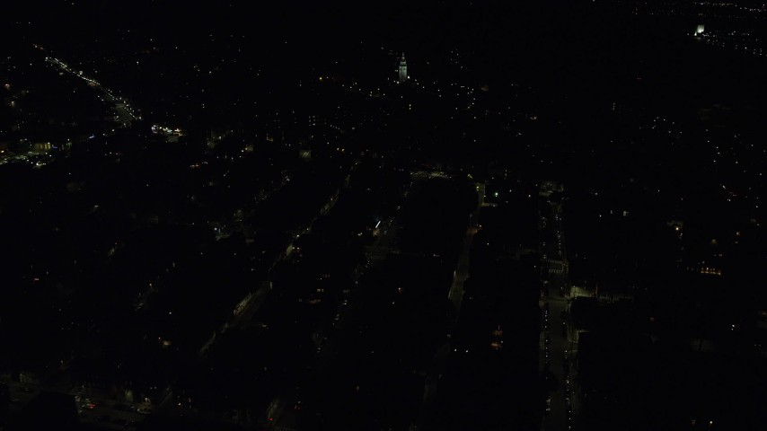 6K stock footage aerial video flying by Dorchester Heights Monument, city lights, South Boston, Massachusetts, night Aerial Stock Footage | AX141_221