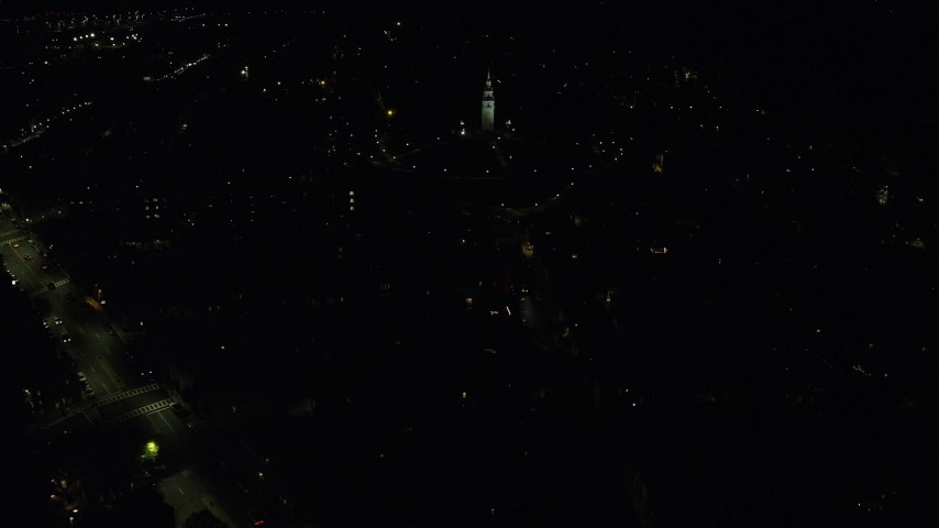 6K stock footage aerial video flying by city lights, Dorchester Heights Monument, South Boston, Massachusetts, night Aerial Stock Footage | AX141_222