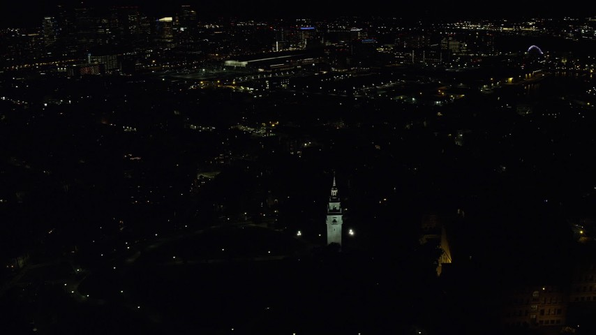 6K stock footage aerial video orbiting Dorchester Heights Monument, skyline, South Boston, Downtown Boston, Massachusetts, night Aerial Stock Footage | AX141_224