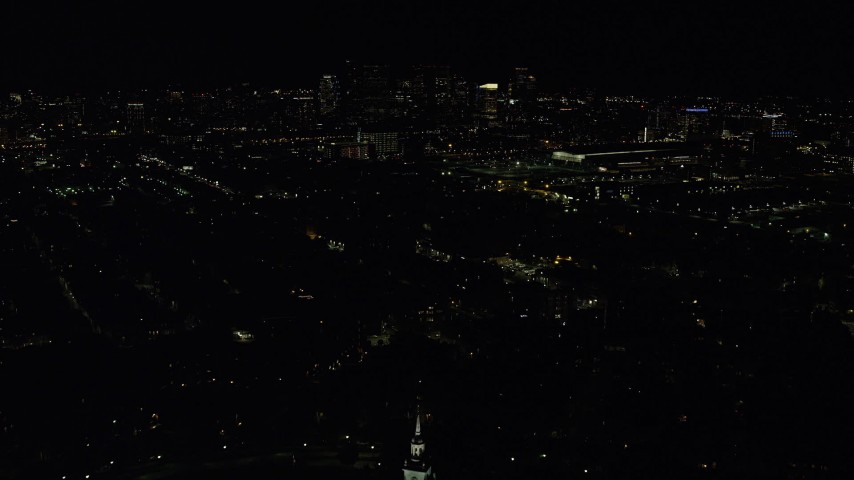 6K stock footage aerial video approaching the skyline, Downtown Boston, Massachusetts, night Aerial Stock Footage | AX141_232