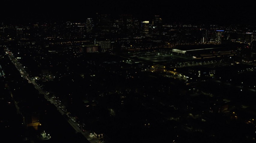 6K stock footage aerial video flying over city lights, approaching skyline, Downtown Boston, Massachusetts, night Aerial Stock Footage | AX141_233