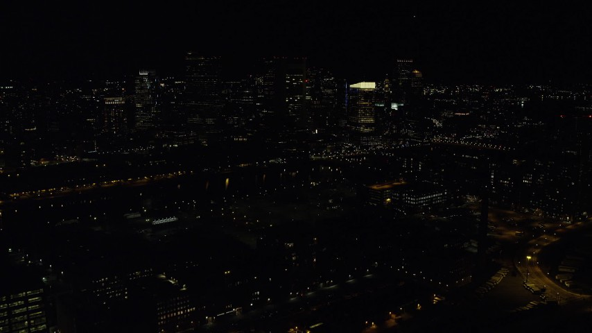 6K stock footage aerial video approaching skyline from over buildings, city streets, Downtown Boston, Massachusetts, night Aerial Stock Footage | AX141_235