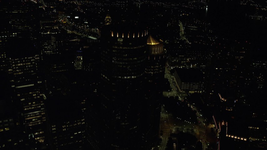6K stock footage aerial video flying over skyscrapers, approach Custom House Tower, Downtown Boston, Massachusetts, night Aerial Stock Footage | AX141_238