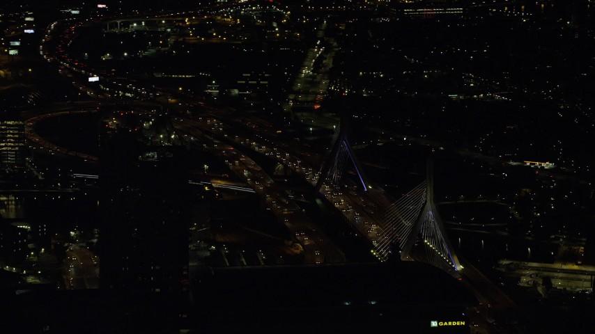 6K stock footage aerial video flying by the Zakim Bridge, Boston, Massachusetts, night Aerial Stock Footage | AX141_241