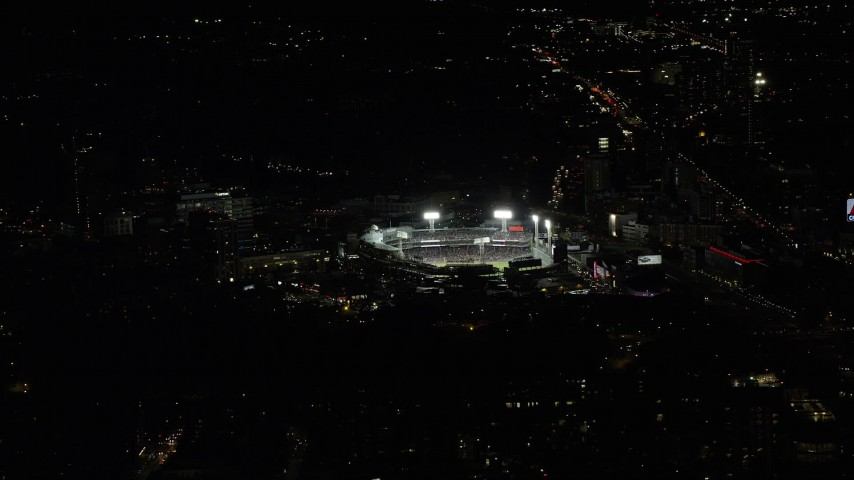 6K stock footage aerial video flying by baseball game in progress, Fenway Park, Boston, Massachusetts, night Aerial Stock Footage | AX141_243