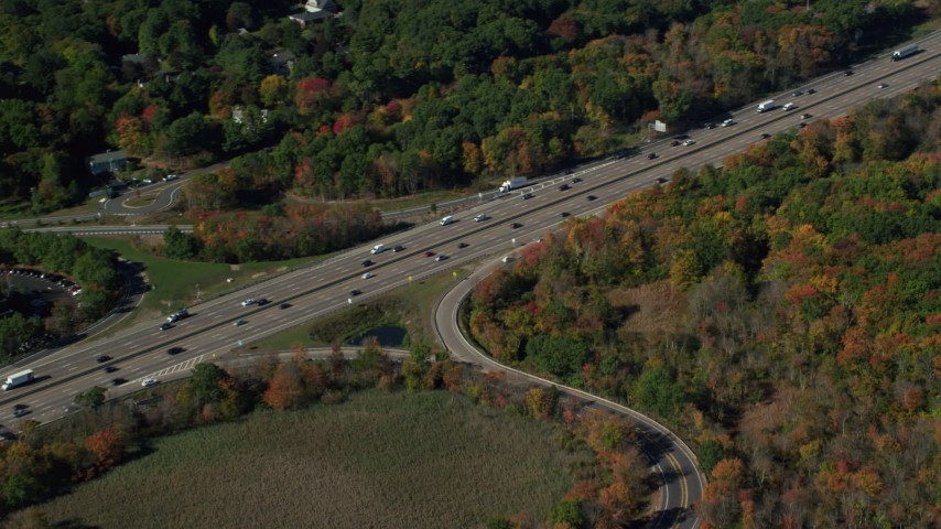 6K stock footage aerial video flying over Interstate 93, homes, trees, autumn, Westwood, Massachusetts Aerial Stock Footage | AX142_006