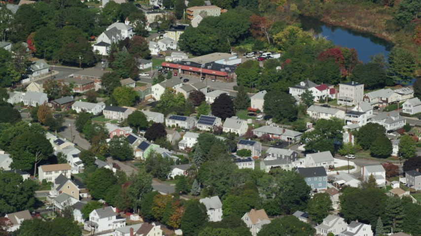 6K stock footage aerial video flying by small town, trees, small pond, autumn, Hyde Park, Massachusetts Aerial Stock Footage | AX142_008