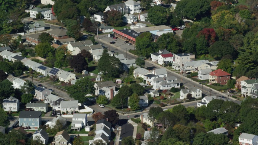 6K stock footage aerial video flying over small town, homes, pond, trees, autumn, Hyde Park, Massachusetts Aerial Stock Footage | AX142_009