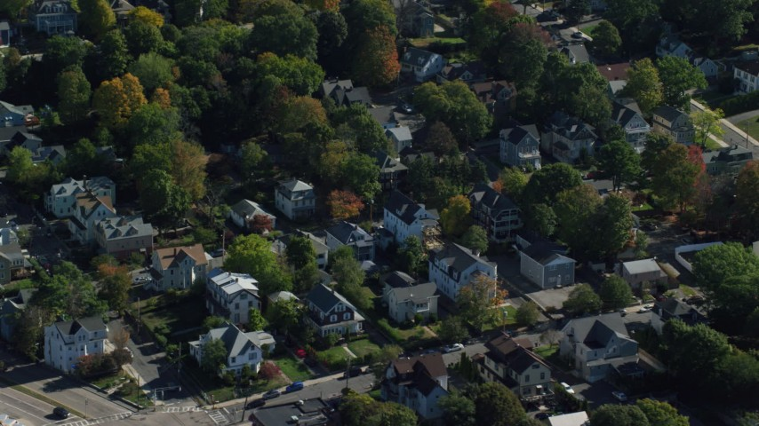 6K stock footage aerial video flying over homes, small town, colorful trees in autumn, Hyde Park, Massachusetts Aerial Stock Footage | AX142_010