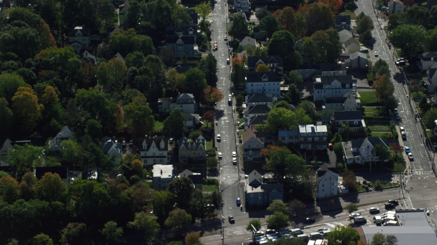 6K stock footage aerial video flying over homes in small town, trees in autumn, Hyde Park, Massachusetts Aerial Stock Footage | AX142_011